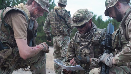 Soldiers discussing where to go on the map