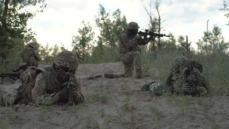 Soldiers in defense position on the battlefield