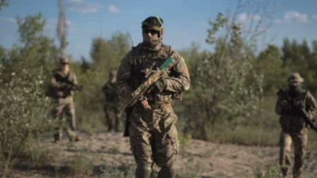 Soldiers troop walking and posing on the field