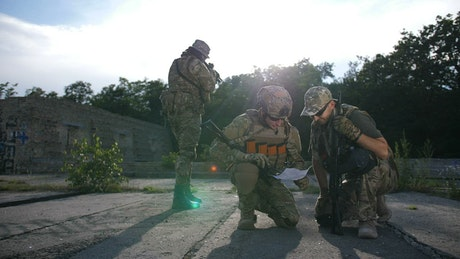 Soldiers using a map