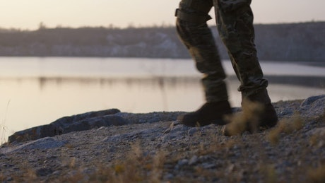Soldiers walkign by the lake