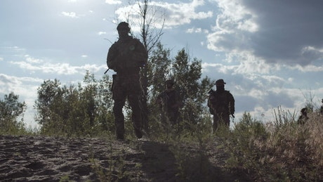Soldiers walking and posing outdoors