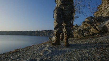 Soldiers walking by the lakeshore