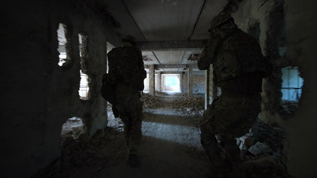Soldiers walking through an abandoned place