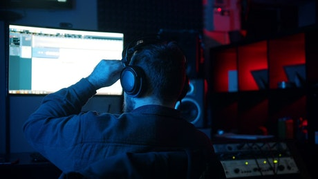 Sound engineer working at his recording studio