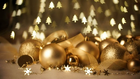 Sparkling gold holiday ornaments and tree lights