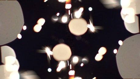 Sparks coming out of a lit sparkler