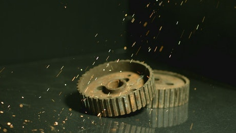 Sparks falling into industrial gears