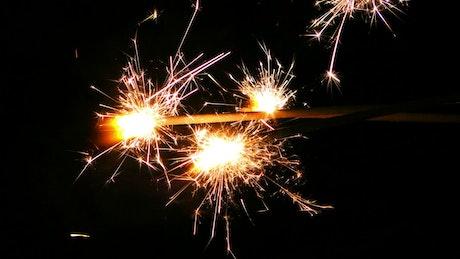 Sparks flame lights burning slowly