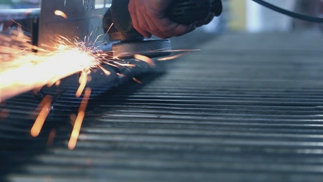 Sparks from a grinder in the factory