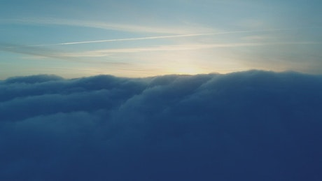 Spectacular sunrise view over the clouds