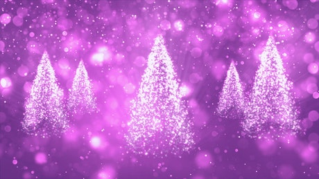 Spinning Christmas trees spinning on purple background
