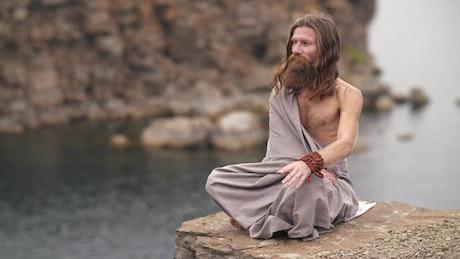 Spiritual man meditating by the sea