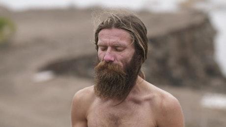 Spiritual man with long beard meditating