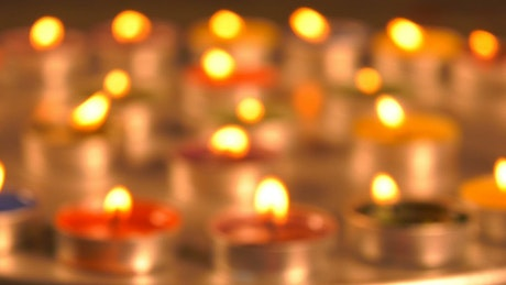 Spiritual stage filled with small candles