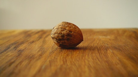 Splitting a walnut with a hammer