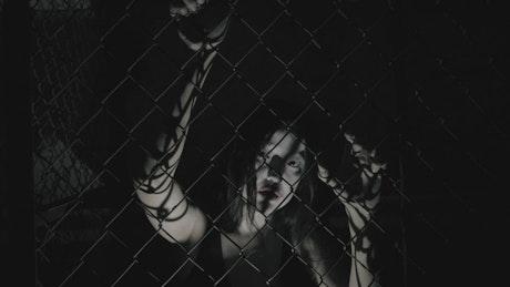 Spooky zombie on a wire net fence