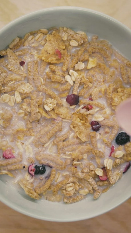 Spoonful of healthy cereal with milk