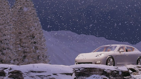 Sports car traveling in a snowing road