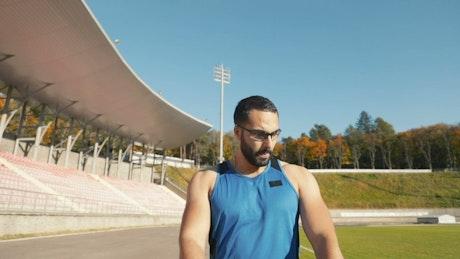 Sportsman Instagram influencer warming up before training
