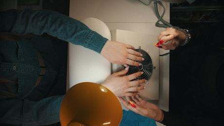 Spraying hand sanitazer before manicure
