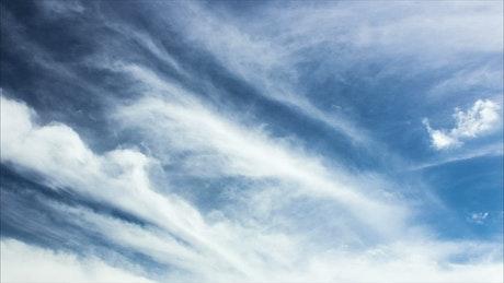 Spring clouds above farmland