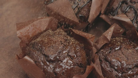 Sprinkle striped chocolate over chocolate cupcakes