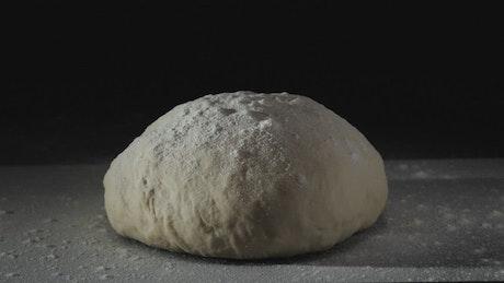 Sprinkling flour on fresh dough