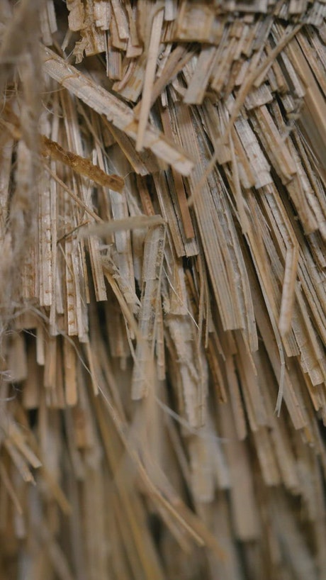 Stacked thin strips of old weathered wood
