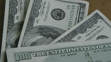 Stacking 100 dollar bills