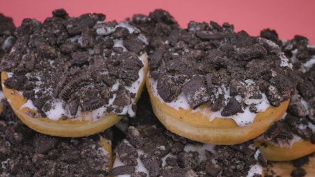 Stacking a tower of donuts with cookie chunks