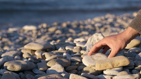 Stacking stones on the beach