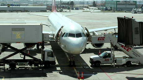 Staff preparing passenger plane for take-off