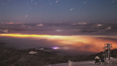Starfall in the sky seen from the mountains