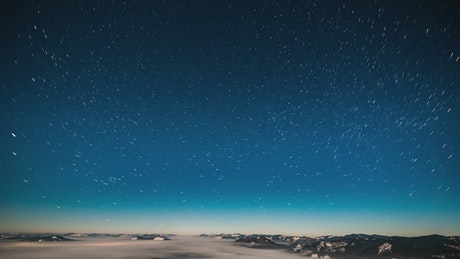 Starry sky at night over the mountains