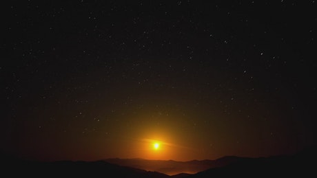 Starry sky moving at night with a bright moon