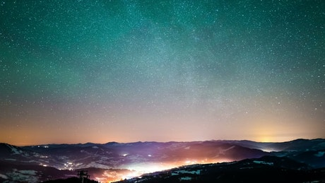Starry sky over a village in the mountains