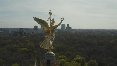 Statue of a golden angel on a tower in Berlin