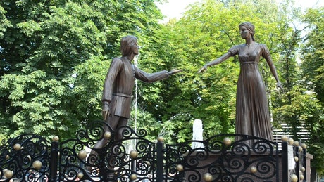Statues reaching for each other