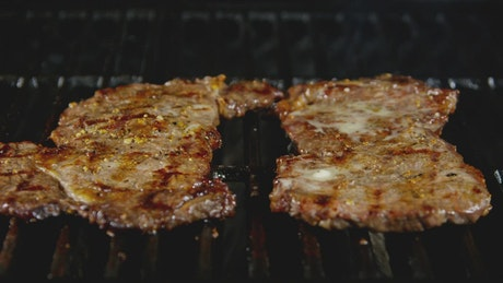 Steaks on a hot BBQ grill