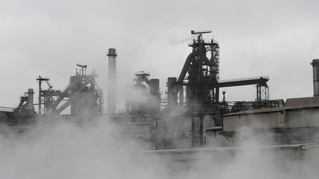 Steam rising from an industrial site