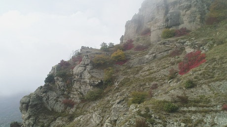 Stone cliffs covered by mist