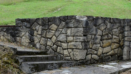 Stone wall with a metal gate