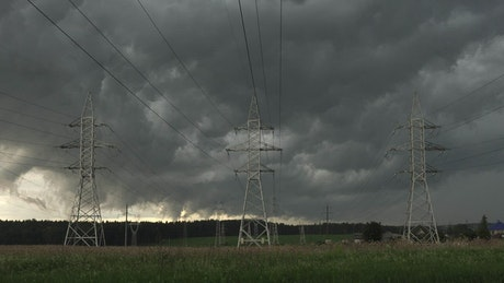Storm clouds moving over power lines