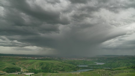 Storm clouds over the green valley
