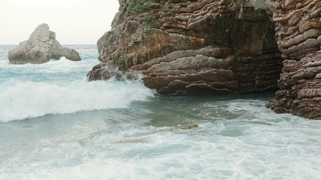 Stormy sea breaking its waves on the rocks