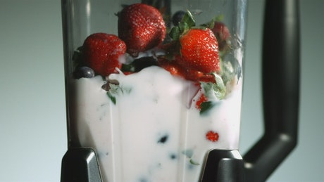 Strawberries and blueberries in the blender