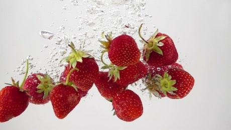 Strawberries going through water