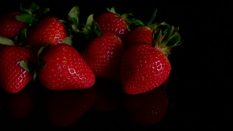 Strawberries on a dark table