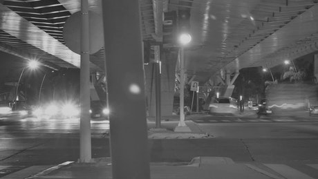 Street below a peripheral in the city in black and white